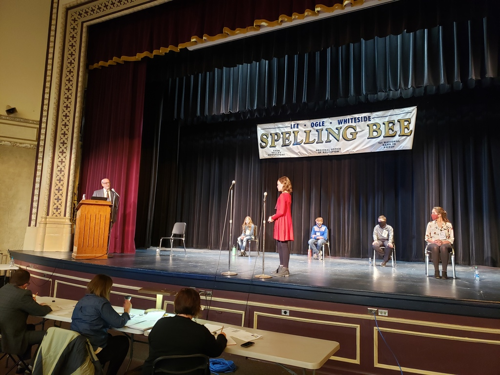 Photo of spelling bee stage and students