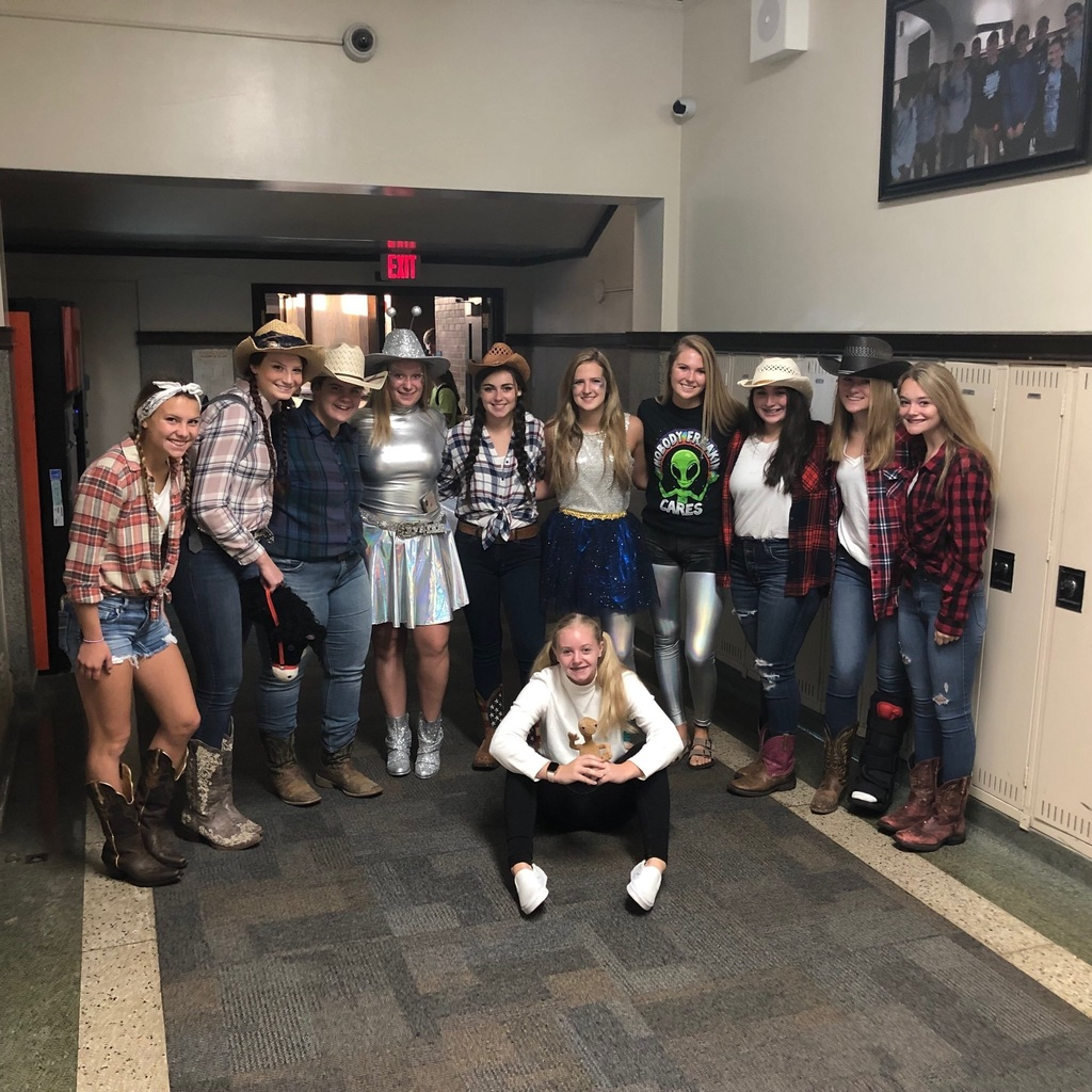 Photo of high school students in cowboy and alien attire