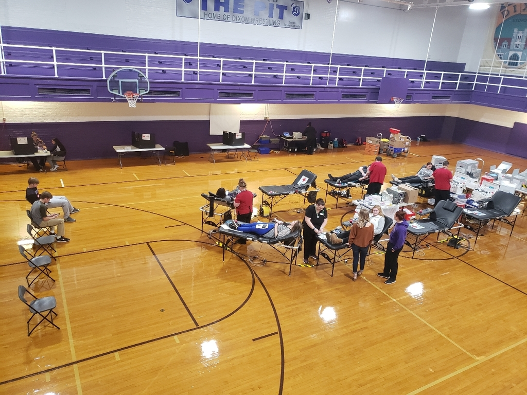 photo of blood donation tables and donors