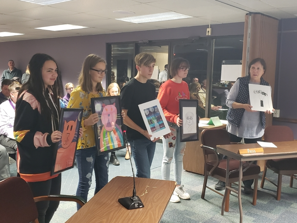 Mrs. Hamer and 4 students with their artwork