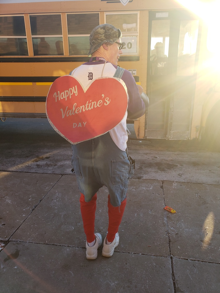 Dr. Grady wearing a Valentine's sign