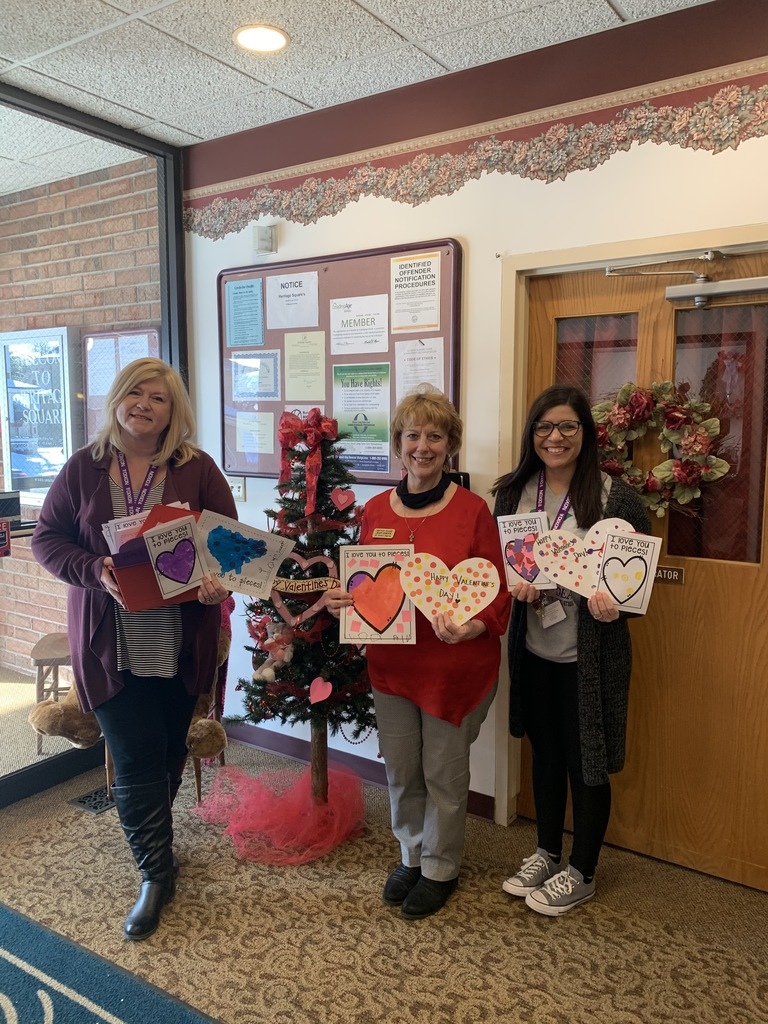photo of staff holding valentines at Heritage Square