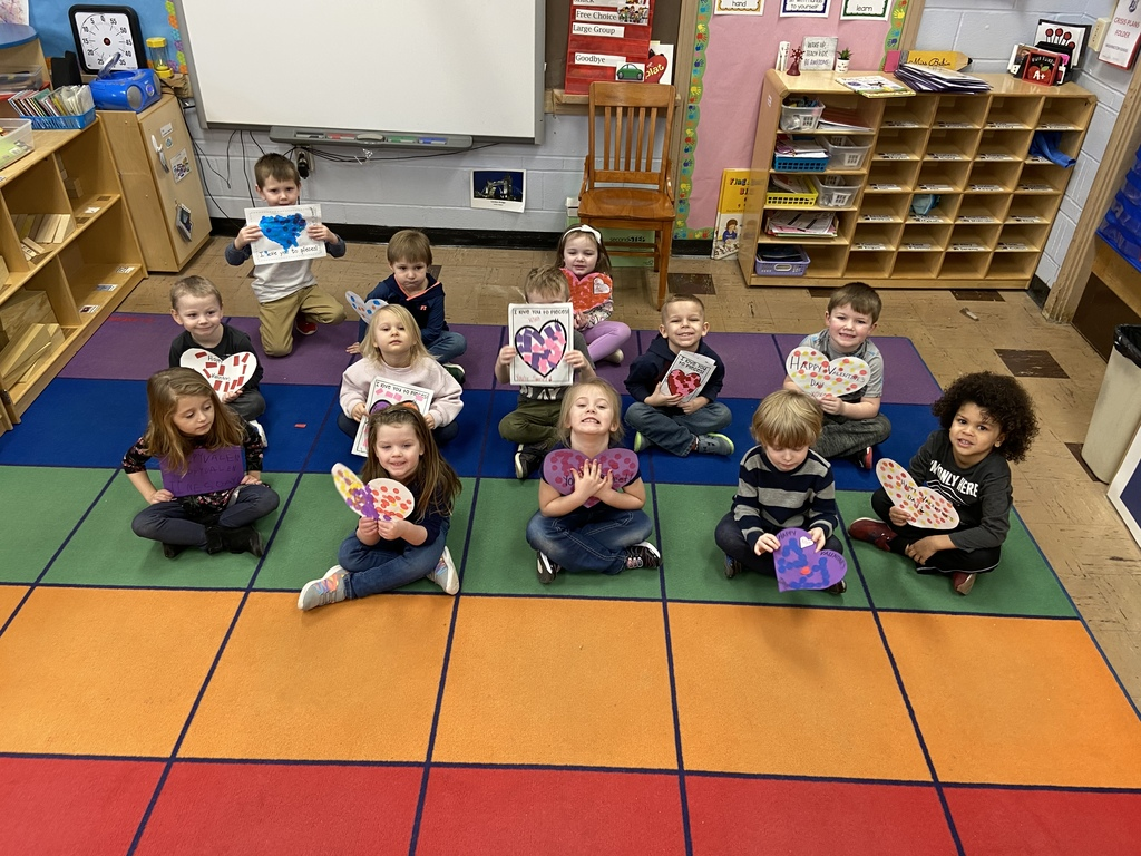 Photo of pre-schoolers holding valentines