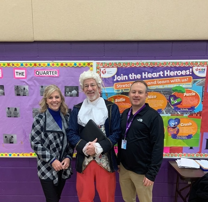 Photo of 2 teachers with community member dressed as Thomas Jefferson